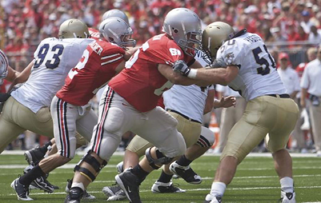 Buckeye football player Justin Boren blocking for Dane Sanzenbacher in a game against Navy in 2009