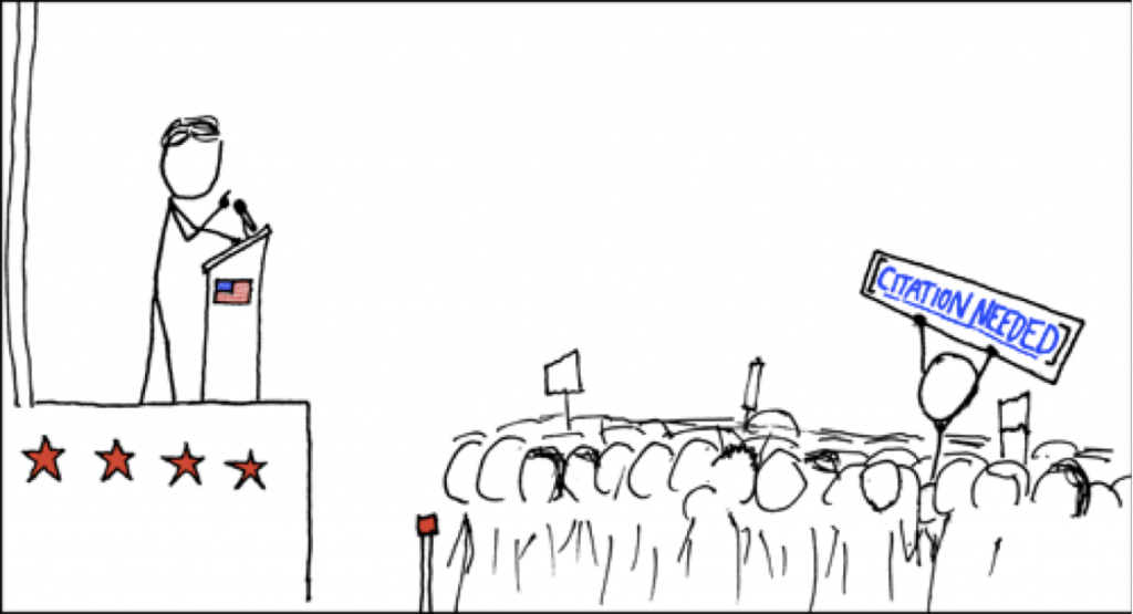 A stick figure drawing of a man giving a speech as an audience member in the crowd holds up a protest sign reading CITATION NEED.