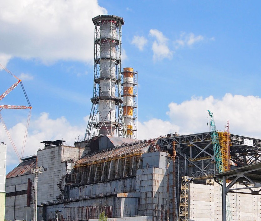 Chernobyl Reactor Tower Against Sky Background Years After Destruction