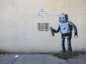 street mural of a robot painting a barcode