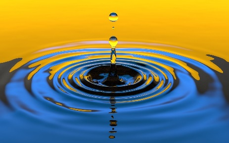 a drop of water splashing and forming concentric circles