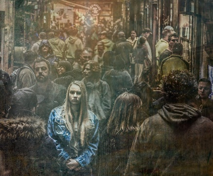 young girl surrounded by a large crowd