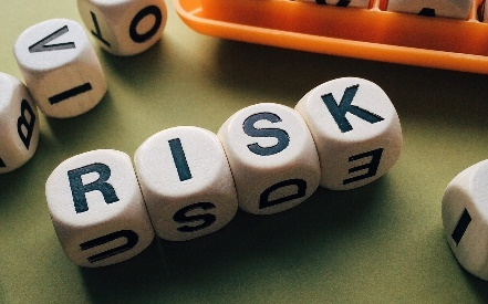 "the word ""Risk"" spelled out with dice"
