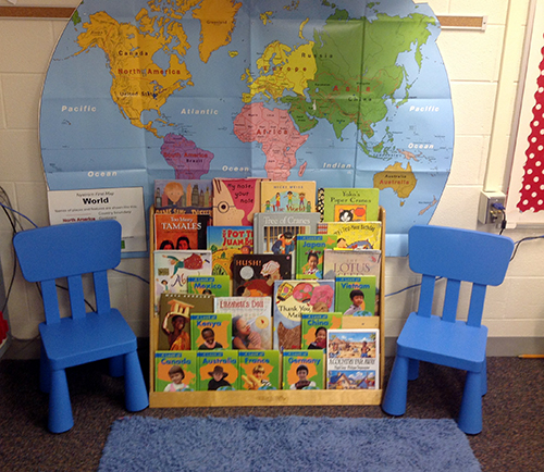 Book display in front of world map