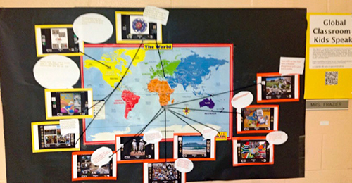 World map with images and notes pinned to it
