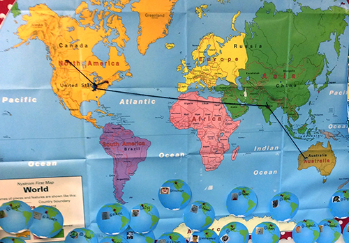 Wolrd map with notes and pins showing connections students have made around the world