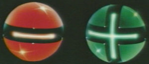 a red all with a negative sign and a green ball with a plus sign