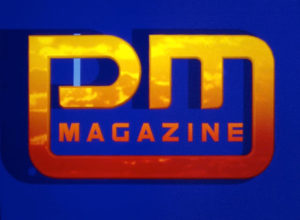PM Magazine cover, yellow and orange letters with a blue background