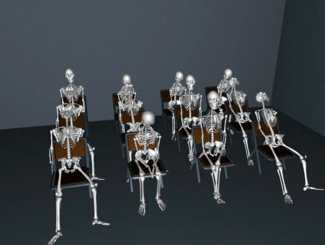 skeletons in chairs in class