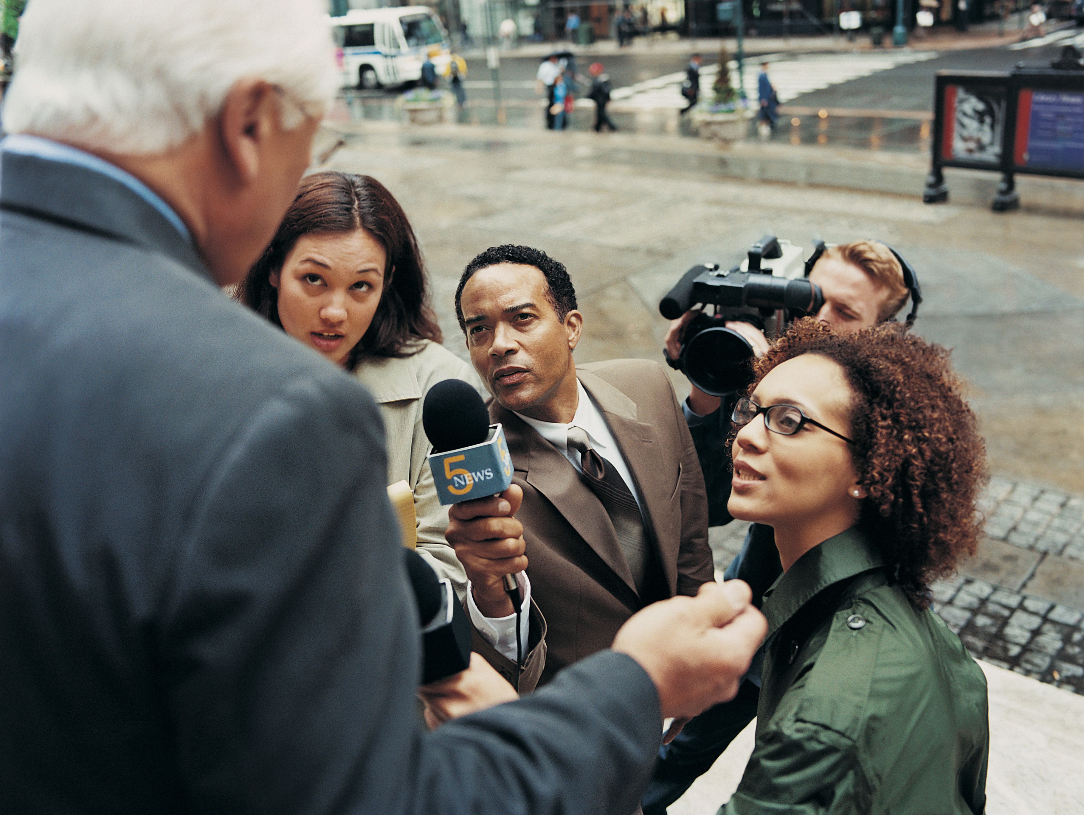 """News Reporters and a TV Cameraman"" by Digital Vision is licensed under CC BY 2.0."