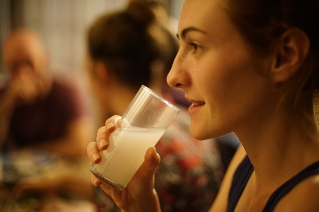 Image of Girl Drinking a Glass of Raki with Water
