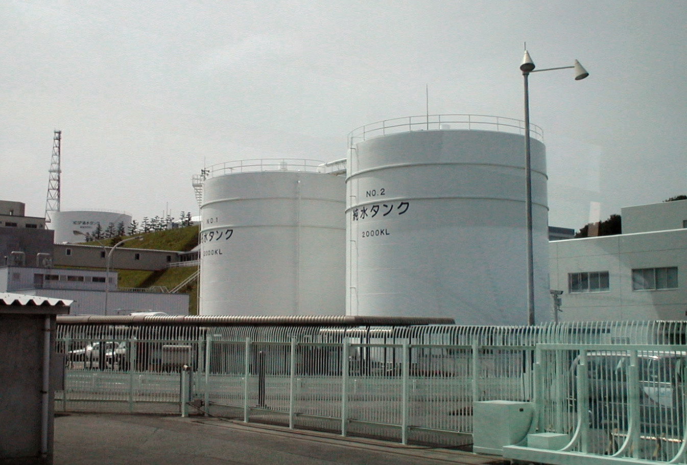 two reactors at the Fukushima Nuclear Power behind a metal fence