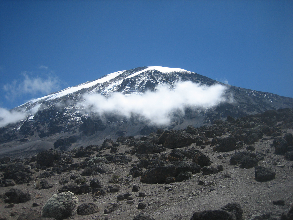 mount Kilimanjaro with clouds covering some of the base